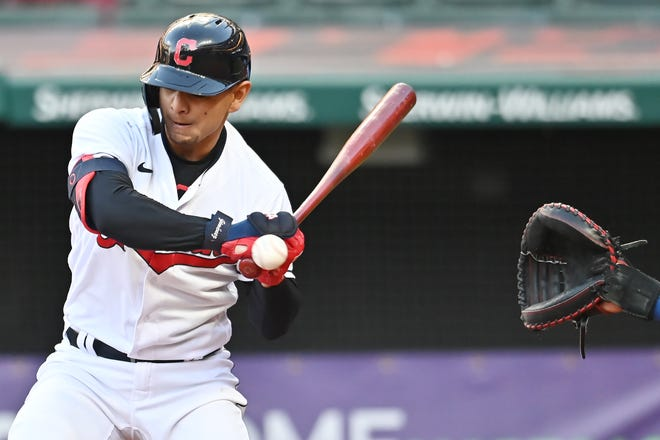 May 11, 2021; Cleveland, Ohio, USA; Cleveland Indians shortstop Andres Gimenez (0) is hit by a pitch during the fifth inning against the Chicago Cubs at Progressive Field.