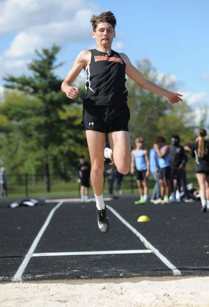 Marlington's Brendan Hamilton, shown here earlier this season, became a Division II regional qualifier in the long jump on Thursday.
