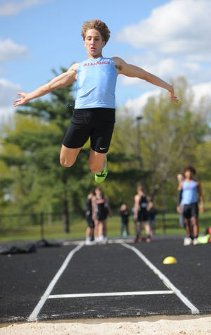 Alliance long jumper Dylan Bugara, shown in an earlier competition, finished second in the event at the Division I district championships Wednesday at Austintown Fitch, qualifying for next week's regional championships, also at Austintown.