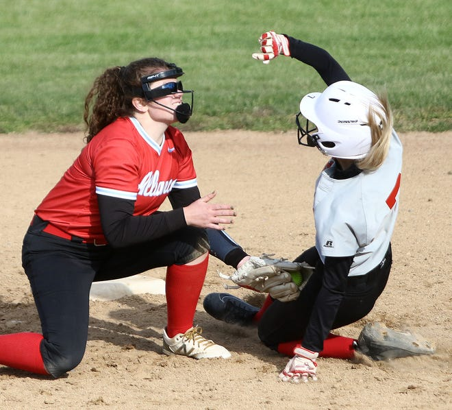 Alliance's Cameryn Mullaly, left, puts the tag on Struthers' Mary Bayus at second base during tournament play at Alliance High School Tuesday, May 11, 2021.