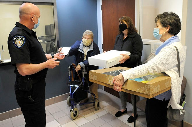 Ashland Police Division Capt. Dave Lay greets Marge Yetzer, Sherri Schafrath and Deborah Madden from St. Edward Church as they were delivering cookies to the department on Wednesday, May 12.