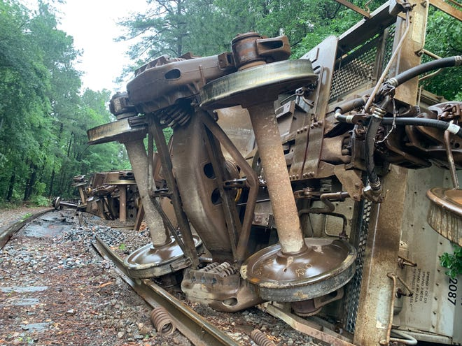 A train derailed on Riverwatch Parkway in Augusta, Ga. on May 11, 2021, throwing 14 gravel containers on their side. The road was cleared the next day, but the cars were still on their side.