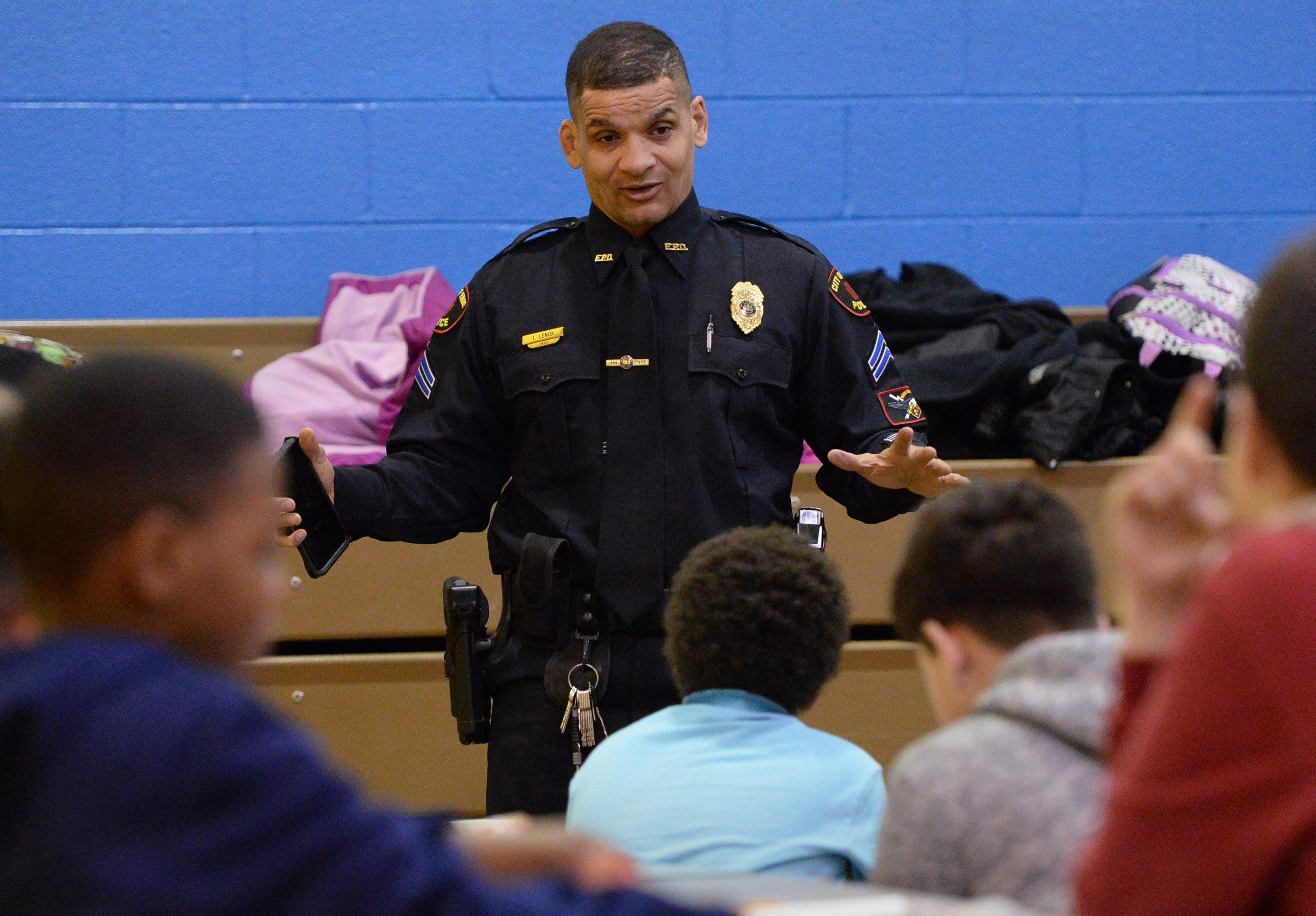 Erie Bureau of Police Cpl. Tom Lenox talks with students during a Police Athletic League after-school program at Pfeiffer-Burleigh Elementary School in Erie in this March 21, 2018 file photo. Lenox, who has since been promoted to sergeant, is leading the Erie Bureau of Police's efforts to bring more diversity to the 173-member department.