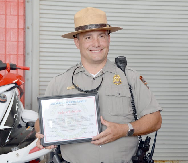 U.S park ranger Andrew Robinson was awarded the Citizens Life Saving Award April 14 for saving two young adults from double red flag waters on a Saturday afternoon.