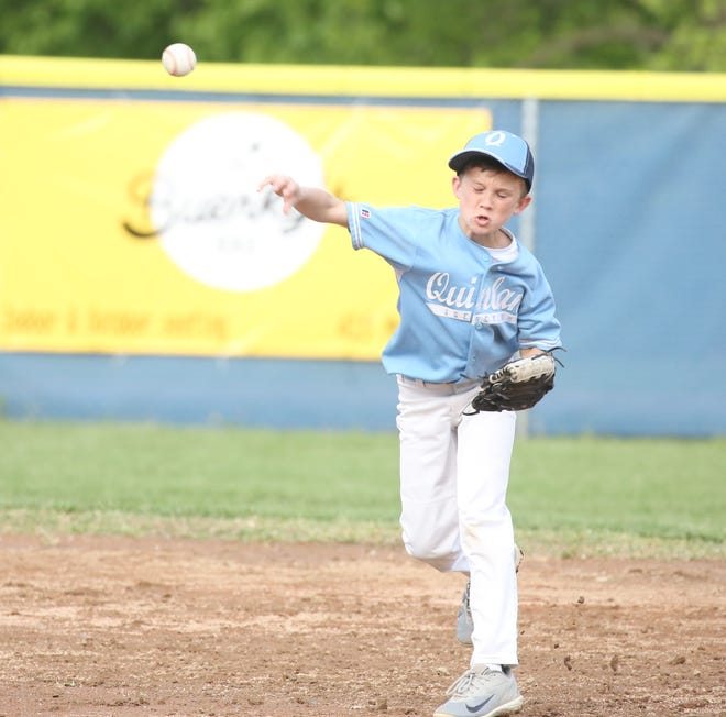 QuinlanAgency.com shortstop Noah Hackman throws to first to get the runner out Monday night against Einspahr Construction in Cal Ripken Major at the COCOBA Ballfield. QuinlanAgency.com pulled off the upset by knocking off previously unbeaten Einspahr Construction 6-5.