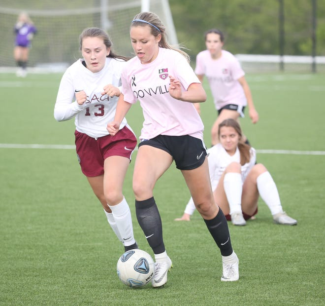 Boonville freshman Ava Esser pushes the ball downfield in the first half Tuesday night against Osage at the Boonville City Soccer Field. The Lady Pirates fell in double overtime against Osage 3-2.
