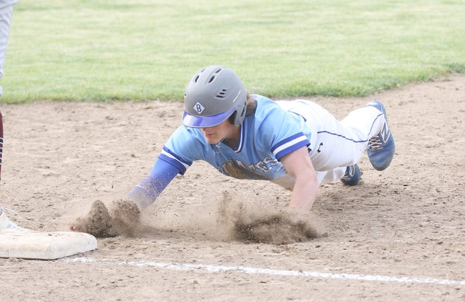 Boonville senior Peyton Taylor dives back to first in the sixth inning Tuesday night against Osage in Tri-County Conference action at Twillman field in Harley park. The Pirates improved to 13-5 overall and 4-3 in the TCC by beating Osage 10-1.