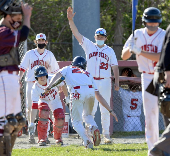 """Gibson Guimond (22) celebrates with his Barnstable teammates after scoring in the fourth inning against Falmouth. """"We had the bats going all day today,"""" Guimond said. """"Everyone was making solid contact and putting the ball in play, so just great hitting overall by the team."""""""