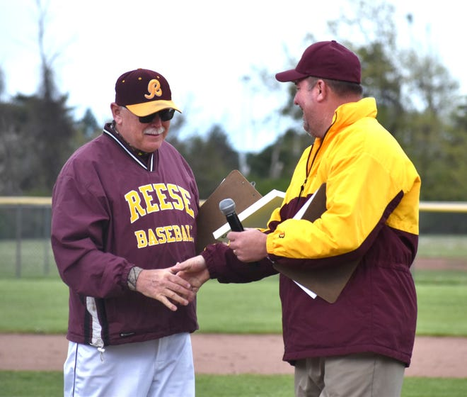 Cheboygan native and longtime Reese High School head varsity baseball coach Dave Elliott, left, recently earned his 500th career coaching win with the program.