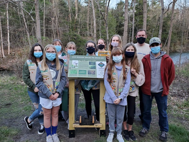 Part of Girl Scout Troop 40629 project was educating Outlet Trail hikers about invasive species.