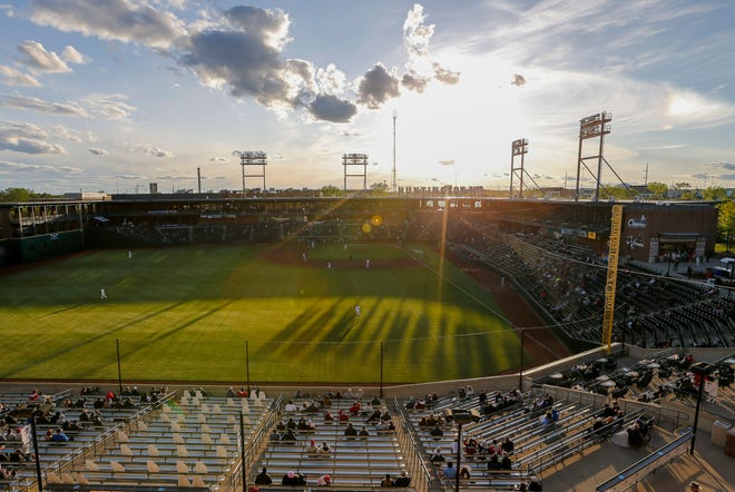 The sun sets behind Huntington Park during the Columbus Clippers opening day Triple-A baseball game against the Omaha Storm Chasers at Huntington Park in Columbus on Tuesday, May 11, 2021.
