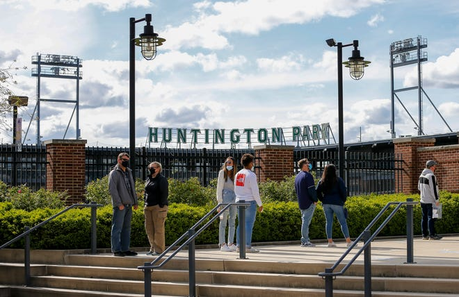 Fans line up outside the front gate to enter the Columbus Clippers' 2021 opening day Triple-A baseball game against the Omaha Storm Chasers at Huntington Park.