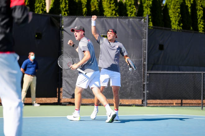 The Ohio State doubles team of Robert Cash, left, and John McNally celebrate after winning their match in a second-round NCAA Tournament victory over Wake Forest on Saturday.