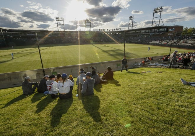 Fans take in the Clippers' 2021 home opener on Tuesday from the picnic spaces beyond the outfield as live professional baseball returned to Columbus  for the first time in nearly 19 months.