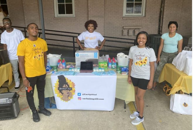 Volunteers with Spiritual Eats give away school supplies and other necessities during last year's back-to-school event.