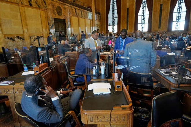 Ted James  (second from right), D-Baton Rouge, chairman of the Legislative Black Caucus, talks with fellow caucus members during the opening day of the Louisiana legislative session April 12 at the state Capitol.