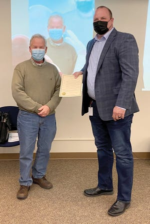 Crookston MayorDale Stainbrook, left, and Tri-Valley CEO Jason Carlson are pictured at this week's city council meeting.