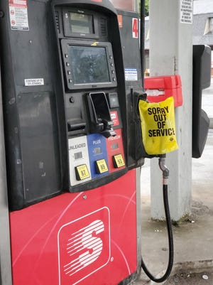 Yellow bags placed over gas pump handles greeted many area residents last Wednesday who were looking to fill up.