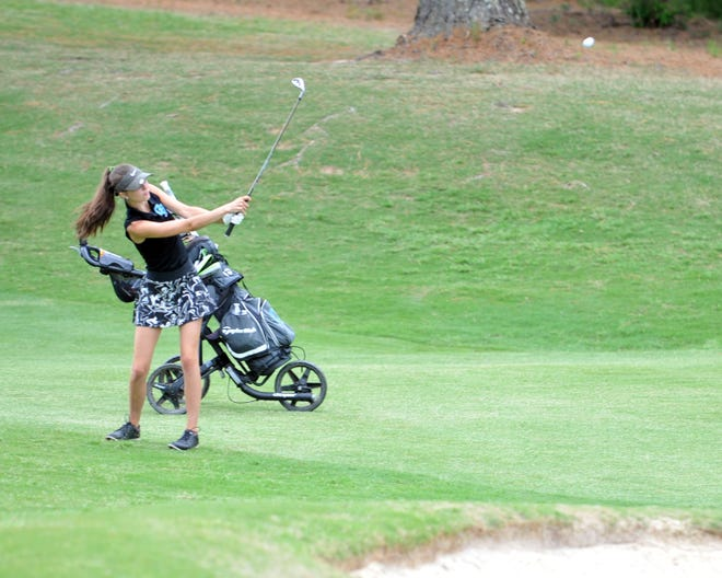 Oak Grove's Kaitlyn McDonell chips onto the 16th green at Pinehurst No. 8 in the 1-A/2-A state tournament on Tuesday. [Mike Duprez/The Dispatch]