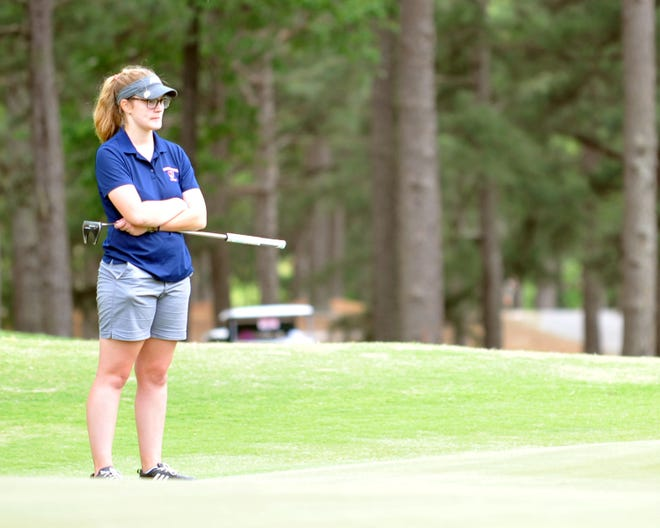 Providence Grove's Caroline Wright watches one of the players in her three-some putt on the 18th hole at Pinehurst No. 8 on Tuesday. [Mike Duprez/Courier-Tribune]