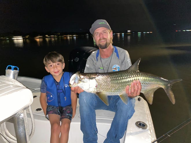 Capt. Jeff Patterson and Connor Grasso with a night tarpon.