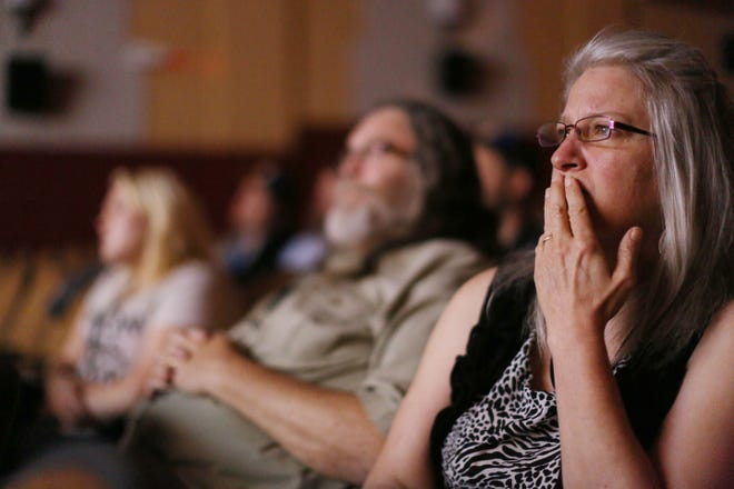 """In this file photo, Kathy Mittan of Red Cloud, Nebraska, watches """"Ragman"""" with her husband Chuck and their daughter, Molly, during the Snake Alley Festival of Film, at the Capitol Theater in downtown Burlington. The long-delayed Snake Alley Festival of Film will return to the Burlington Capitol Theater, 211 Third St., from Aug. 5 to 8."""