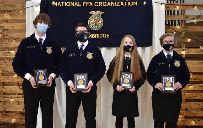 """On Saturday, April 24, Cambridge FFA presented the PRIDE award to one student in each class who exemplified the FFA motto of """"Learning to Do, Doing to Learn, Earning to Live and Living to Serve."""" From left are senior Brant Casteel, junior Cameron Pace, sophomore Rachel Stropes and freshman Taylor Pace."""