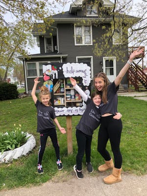 Caroline, Mary, and Amelia Webel celebrate a full Blessing Box as part of the Altrusa/Thrivent event in April.