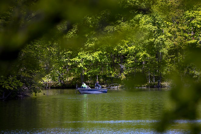 A pair of fishermen try their luck in a cove at Lake Storey on Wednesday, May 12, 2021.
