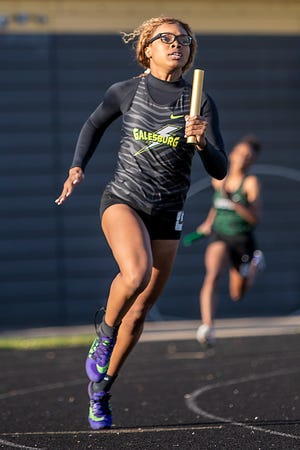 Galesburg's Syriah Boyd makes the turn as she competes in the 4x200 meter relay during the Silver Streaks' track and field meet with Richwoods and Manual on Tuesday, May 11, 2021 at Van Dyke Field.