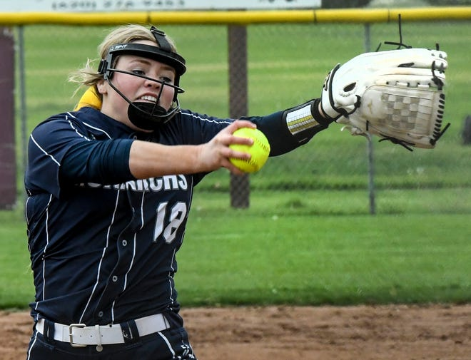 Thomas More Prep-Marian's Madison Augustine winds up to make a pitch to a Garden City batter Tuesday at Tangeman Sports Complex in Garden City.
