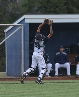 TMP's Caden Morgan catches a foul pop-up in Game 1 vs. Garden City on Tuesday at TMP.