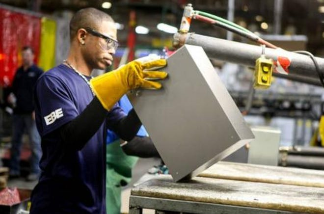 Garrick Hubbard welds together an encasing at Eaton's Sherman facility. The SEDCO board of directors approved a $67,200 incentive for Eaton related to a new building Tuesday.