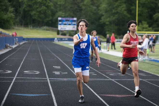 West Henderson's Ian Hicks celebrates his victory in his 200 heat Tuesday night at West's third quad meet of the season.