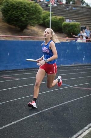 Bre Budzinski runs the 4x400 relay for the Falcons at Tuesday's meet.