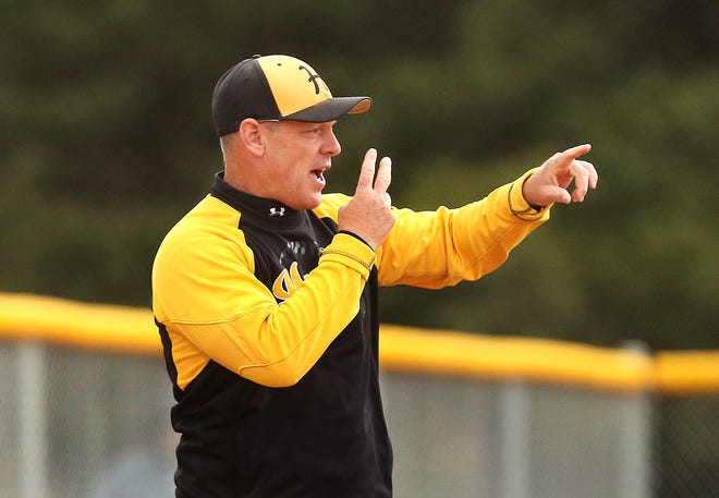 Haven's head softball coach Darin Ashworth calls out to his players Tuesday during their game against Smoky Valley. Haven defeated Smoky Valley 12-1 in five innings in the first game and 6-0 in the second, winning the Central Kansas League championship.