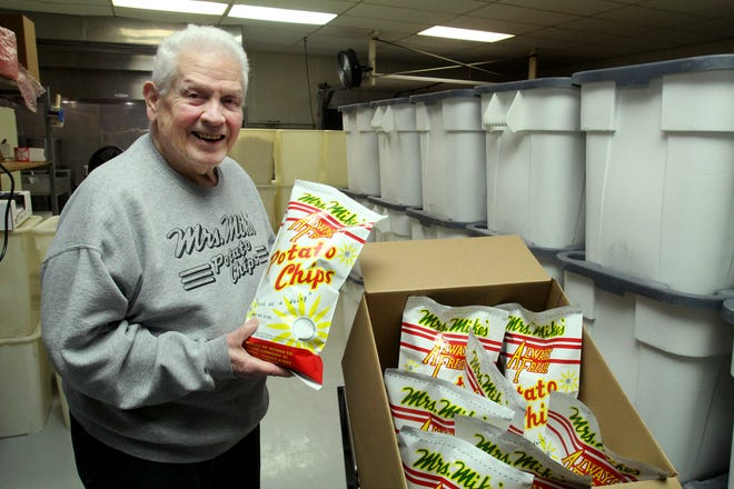 Mrs. Mike's owner Butch Mordick holds a bag of the popular Freeport-made potato chips on Thursday, May 6, 2021, in a packaging room at Mrs. Mike's. Mordick has owned the company for 50 of the 100 years it has been in business.