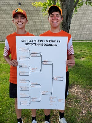 The Kirksville doubles team of Gavin Pike, left, and Jacob Doman pose with their bracket after winning the Class 1 District 8 doubles title.