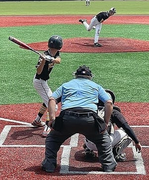 Hornbeck's Cayden Fox awaits a pitch during action Tuesday against Harrisonburg. Fox had two hits, two runs scored and two RBIs in leading the Hornets to victory, 7-1.
