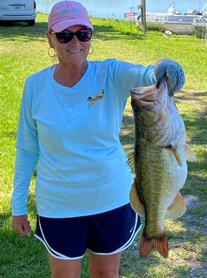 Rita Pearson took big bass with an 8.25 pounder during the West Coast Couples Club tournament May 8 on Lake Pierce.