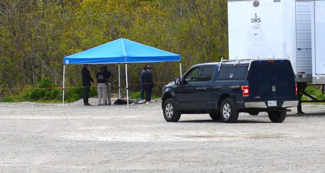 """State police investigators at the scene of what authorities have called an """"unattended death"""" behind a parking lot on Industrial Drive in Leominster on Wednesday, May 12."""