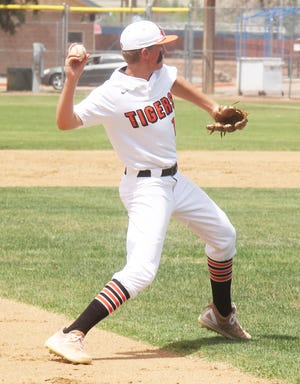 La Junta High School's Trevor Johnston throws out a Lutheran base runner in Saturday's doubleheader at Potter Park. Johnston hit a home run but the Tigers lost at Alamosa 8-6.