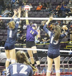 Fowler High School's Kaley Pieper, middle, looks to hit the ball past Vail Christian's Kendelle Smith, left, and Payton Vermeer (13) on May 12, 2021, in a Class 2A state tournament game in Colorado Springs. The Grizzlies defeated the Saints in four sets.