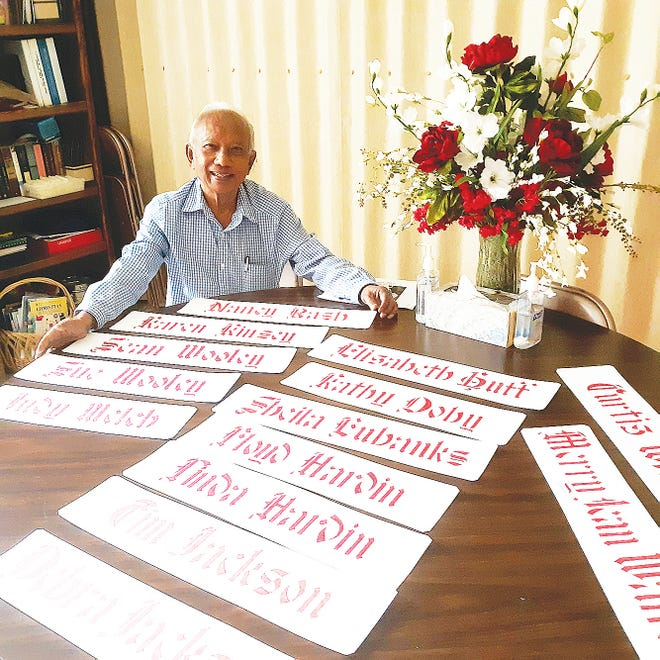Pastor Tim Hutabarat of Southern Heights United Methodist Church is shown with examples of his calligraphy.