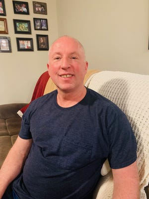 Mark Miller sits at home one evening this week as he talks to the News Tribune about growing up gay in Keyser in the 1980s.