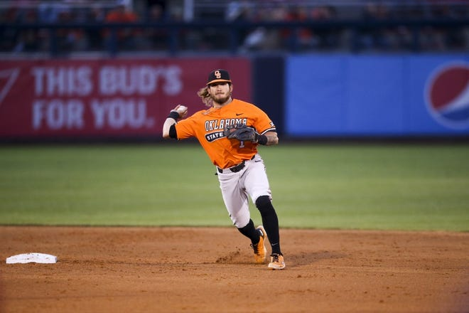 Oklahoma State shortstop Hueston Morrill throws to first base during Tuesday night's Bedlam baseball game against Oklahoma in Tulsa. OSU won the game, 7-3.