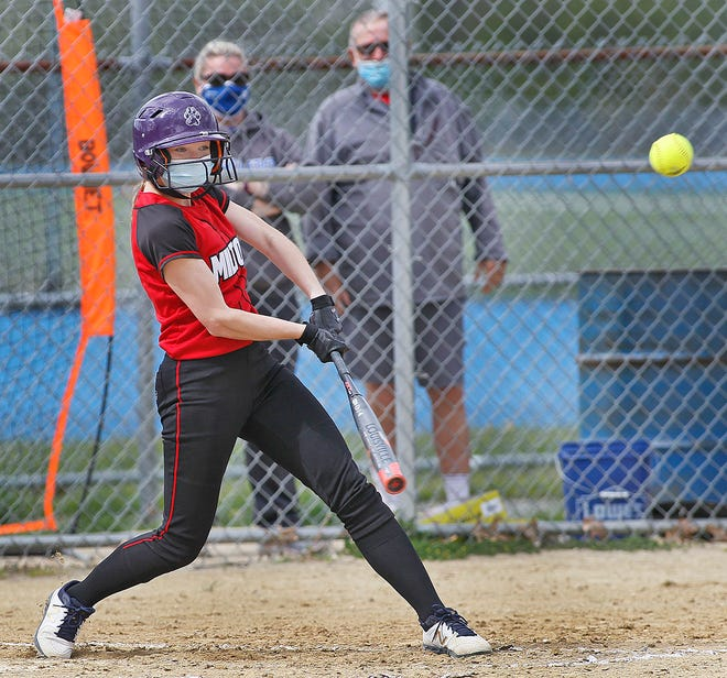 Milton senior Jill Vaughn hits a double. Braintree softball hosts Milton on Wednesday, May 12, 2021.