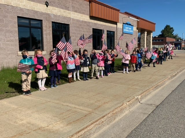 St. Mary students acknowledge law enforcement personnel Wednesday.