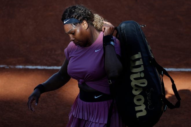 Serena Williams, of Jupiter, leaves the court after losing to Nadia Podoroska at the Italian Open in Rome on Wednesday.