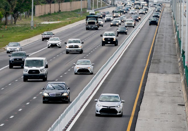 Motorists can use express lanes, right, on northbound I95 at S.W. 10th Street in Deerfield Beach.
